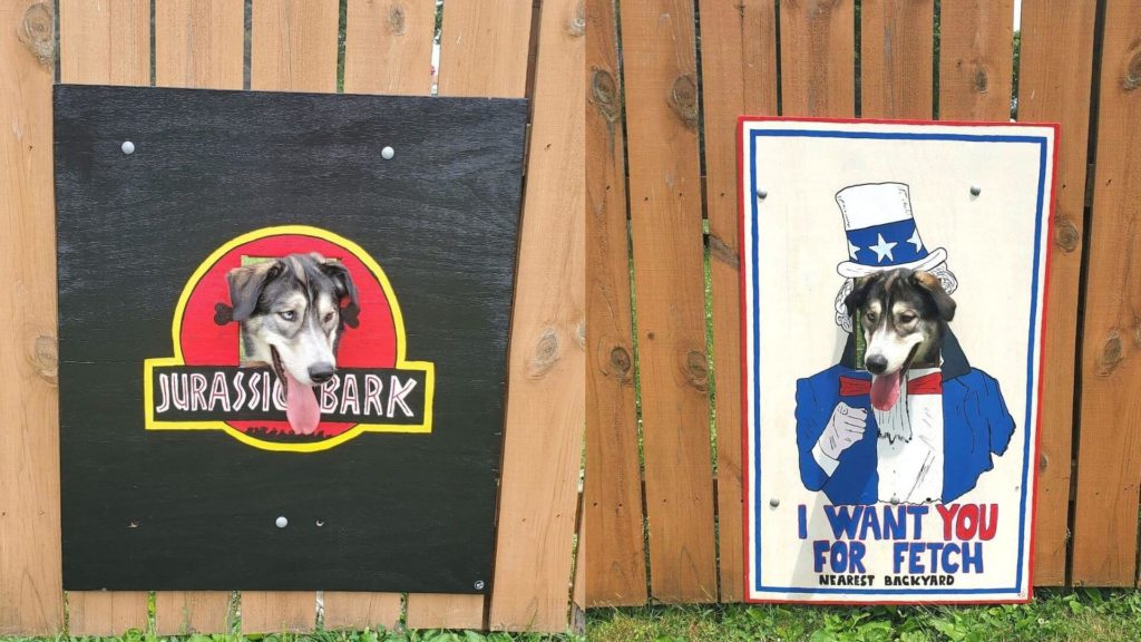 Stanley & his son decided to decorate the hole on their fence for their curious dog with some famous paintings & movie posters. (1)